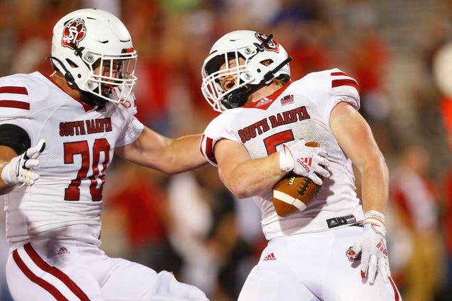 Pratt high school football standout celebrates success Friday at the college level.