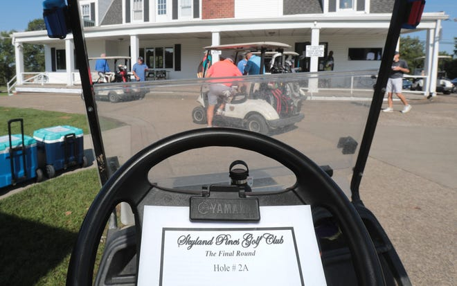 """A scorecard reads """"The Final Round"""" as friends and people close to Skyland Pines play the """"Thanks for the Memories"""" three-man scramble as the last event at the Canton golf course."""
