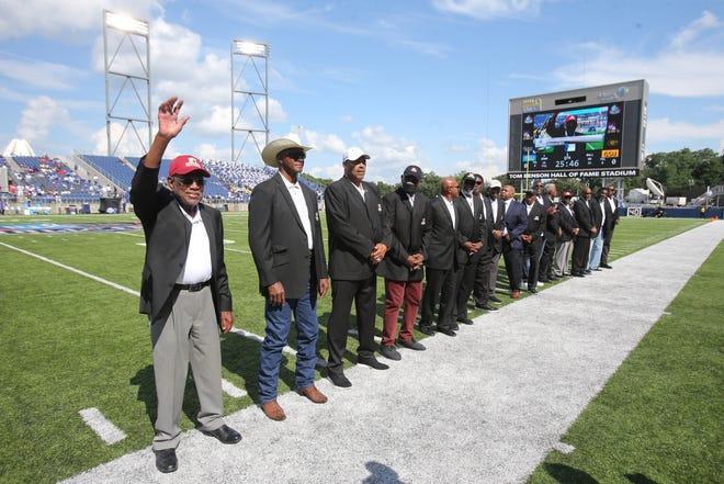 Returning Black Jackets wave to the crowd prior to the Black College Football Hall of Fame Classic at Tom Benson Hall of Fame Stadium in Canton on Sunday, Sept. 5, 2021. At left is coach Willard Bailey, Class of 2021.