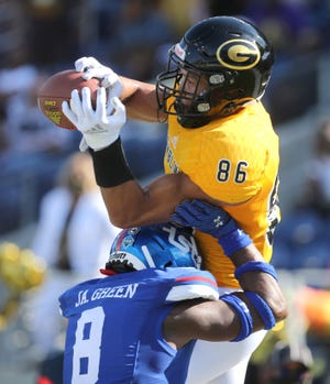 Jaye Patrick, 86, of Grambling State hauls in a touchdown catch while being defended by James Green, 8, of Tennessee State during the Black College Football Hall of Fame Classic at Tom Benson Hall of Fame Stadium in Canton.