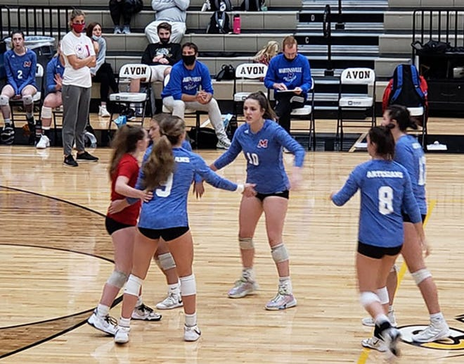 Martinsville players celebrate a point at the Avon Classic volleyball tournament on Saturday, Sept. 4, 2021.