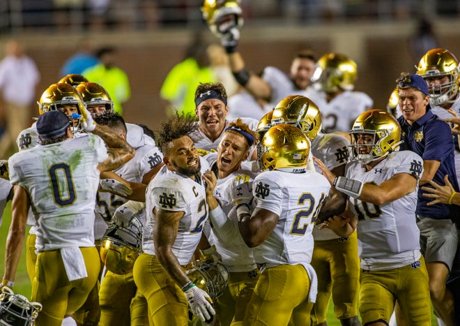 Notre Dame's Jonathan Doerer, center, celebrates with teammates following his the game-winning field goal in Notre Dame's 41-38 overtime win over Florida State on Sunday, Sept. 5, 2021, in Tallahassee, Fla.