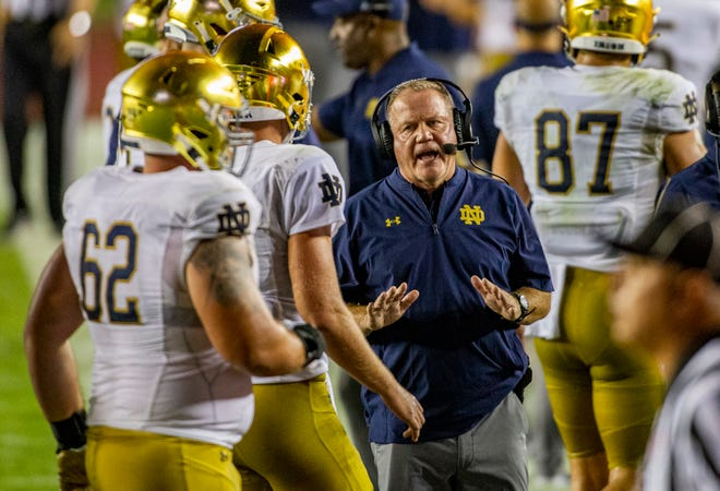 Notre Dame head coach Brian Kelly tries to calm QB Jack Coan (17) during the Notre Dame-Florida State  game on Sunday, Sept. 5, 2021, in Tallahassee, Fla.