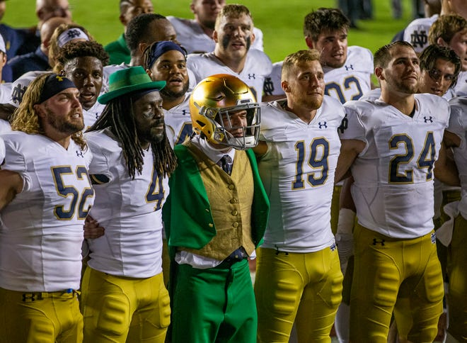 Notre Dame players and the leprechaun mascot sing the Alma Mater following Notre Dame's 41-38 overtime win over Florida State in an NCAA football game, Sunday, Sept. 5, 2021, in Tallahassee, Fla.