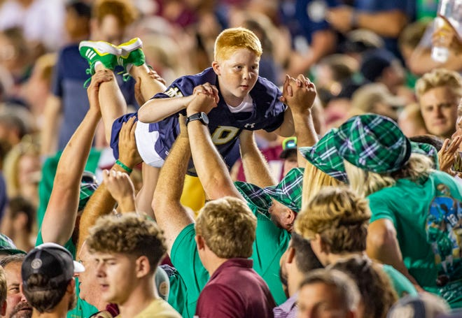 Notre Dame football fans celebrate a touchdown during ND's 41-38 overtime win over Florida State on Sunday, Sept. 5, 2021, in Tallahassee, Fla.