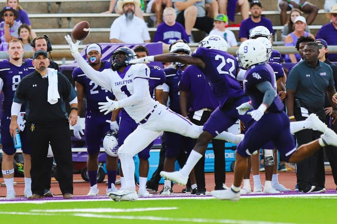 Tarleton's Tariq Bitson reaches for a pass during the Texans' Western Athletic Conference debut Saturday at Homer Bryce Stadium in Nacogdoches.