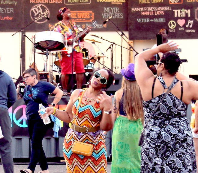 """Zion Lion's Caribbean rhythms had people dancing in the street Sunday in downtown Three Rivers at """"HarmonyFest."""""""