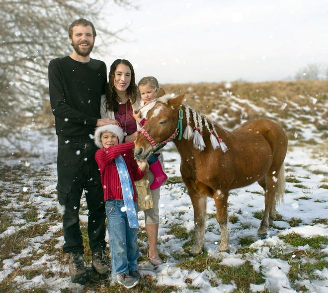 Lindsay and Tony Jordan with their children, Jake and Claire, with rescued pony, Sven.