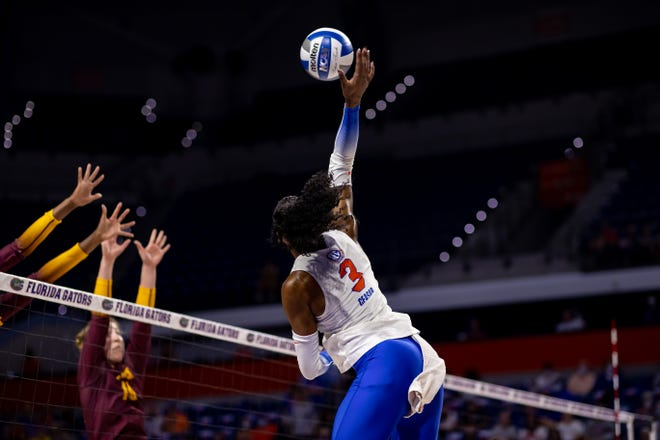 Florida outside hitter T'ara Ceasar smacks the ball Sunday against the Minnesota Gophers at Exactech Arena.