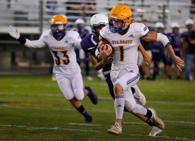 Wildcat quarterback Jayce Moore breaks looks for a touchdown early in game.