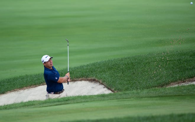 Justin Lower hits from a bunker on the ninth hole during the fourth round of the Korn Ferry Tour Championship at Victoria National Golf Club in Newburgh, Ind., Sunday afternoon, Sept. 5, 2021.
