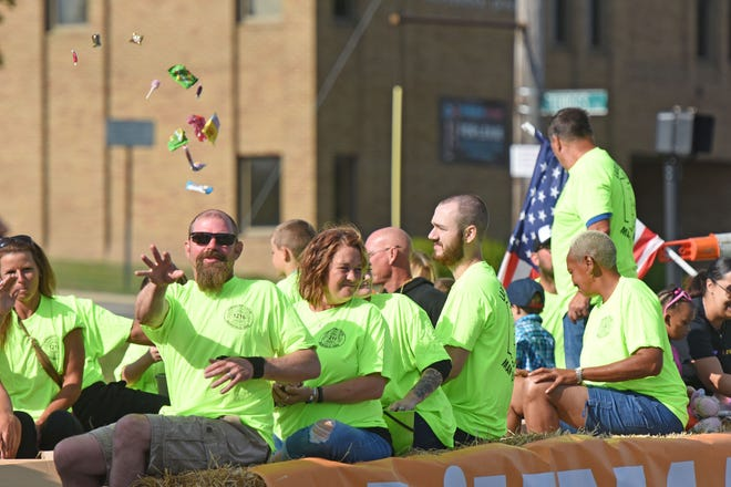 Members of the Laborers' International Union of North America showered parade-goers to candy Monday morning during the 2021 Labor Day parade.