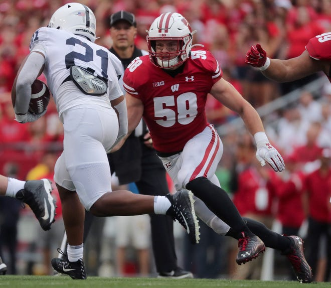 Wisconsin linebacker Mike Maskalunas closes in on Penn State running back Noah Cain during the fourth quarter Saturday.