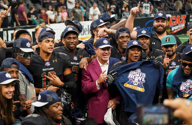 Arizona Rattlers players and owner pose for photos after their 58-55 semi-final win over Duke City Sept, 5, 2021 at the Footprint Center in Phoenix. The Rattlers 58-55 win sends the Rattlers to the United Bowl.