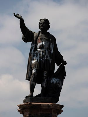 The debate over Christopher Columbus is not limited to the U.S. In this Sept. 28, 2020 file photo, a defaced statue of Columbus stands on Paseo de la Reforma in Mexico City. Mexico City Mayor Claudia Sheinbaum announced on Sunday, Sept. 5, 2021 that the statue will be replaced by a statue honoring Indigenous women.