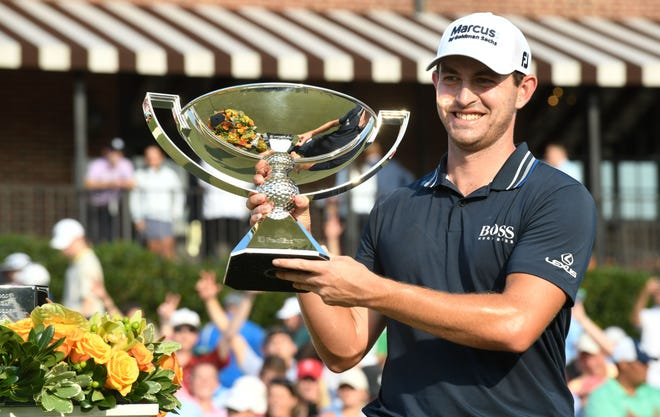 Sept. 5: Patrick Cantlay holds up the trophy after winning the Tour Championship at East Lake Golf Club in Atlanta.