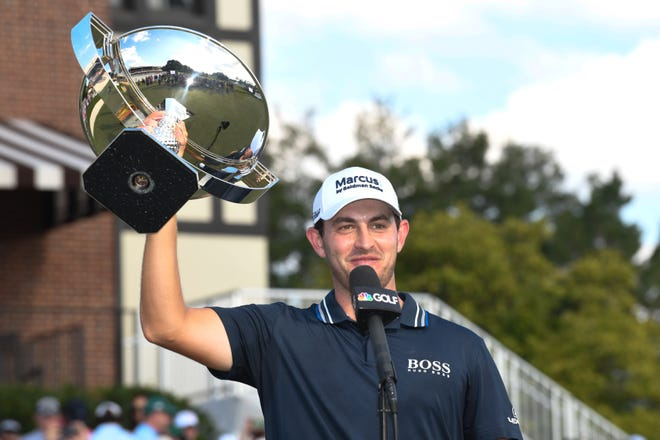 Patrick Cantlay holds up the trophy after winning the Tour Championship.