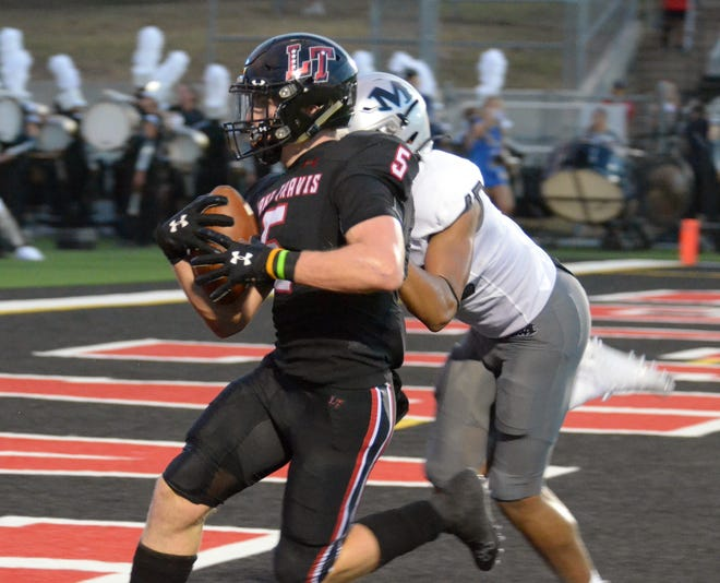 Isaac Norris of Lake Travis, left, scores against Arlington Martin in the season-opener. Norris, a senior, scored four touchdowns in the Cavs' 52-20 win over Converse Judson. He did it in multiple ways, running back a kickoff, catching a pass and twice on the ground.