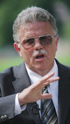 Then-mayoral candidate Joe Finley leads a news conference in August 2007 in downtown Akron. Finley died Aug. 31 at age 72.