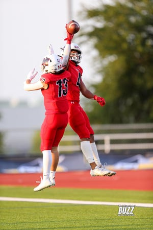 Melissa Cardinals Jacob Kusano (#13) and Jayvon Smith (#4) celebrate a touchdown at Kaykundall Stadium in Frisco, Texas on Sept 3rd, 2021.