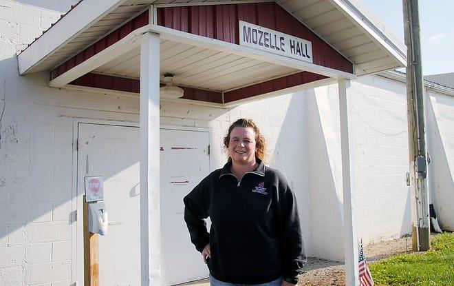 Jackie Wasilewski poses outside of Mozelle Hall at the Ashland County Fairgrounds on Tuesday, Sept. 7, 2021. TOM E. PUSKAR/TIMES-GAZETTE.COM