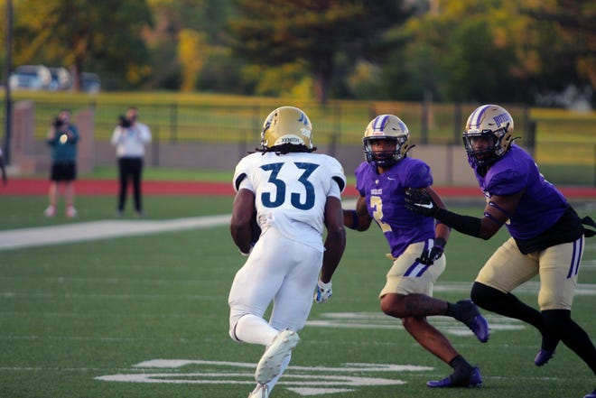 Independence's Tytrayon Lewis (33) runs on a third down attempt against Butler on Saturday, Sept. 4 at BG Products Veterans Sports Complex. He would pick up the first down, while running for 88 yards on the night.