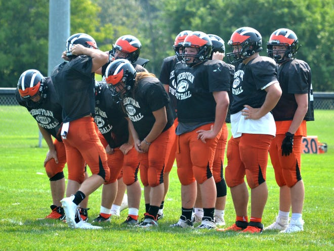 Members of the Cheboygan varsity football team huddle up during a scrimmage against Charlevoix in August. Cheboygan, now 1-1, will head to Grayling for its Northern Michigan Football League Legends season opener on Friday night at 7 p.m.