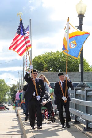 Monday afternoon, a large group of Cheboygan residents and visitors took part in the annual State Street Bridge Walk in the city, led by members of the Knights of Columbus.