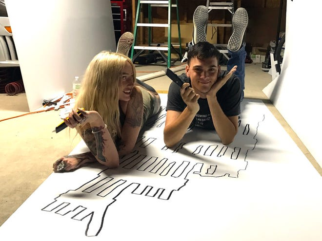 """Dottie Dellamorte and Andrew Daigle joke around during a break from carving out set pieces inspired by photos of the collapsed World Trade Center in preparation for the Sept. 11 """"Crestview Remembers 9/11"""" event."""