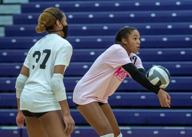 """Central sophomore Myriah Massey has become a force on the court. Some of that is due to her playing beach volleyball. """"Since you're in the sand, you move a bit slower but when you get on the court, you feel like you're going much faster,"""" she said."""