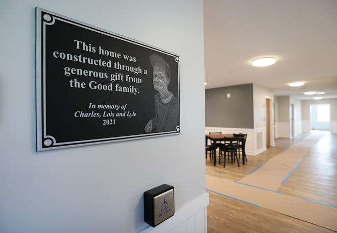 A plaque remembering Charles, Lois and Lyle Good hangs inside the front entrance of a nearly-finished youth home in Etna Township. The 7-acre property is just across the street from the Goods' old family farm, and the purchase was made possible by the Goods' trust fund, which was gifted to the Licking County board upon Lyle's death in 2018.