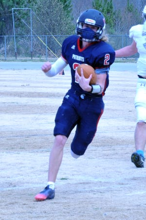 Providence Grove quarterback Luke Thomas, shown here in a spring 2021 game, had a huge night in the Patriots' 54-0 win over Jordan-Matthews on Friday. [Mike Duprez/Courier-Tribune]