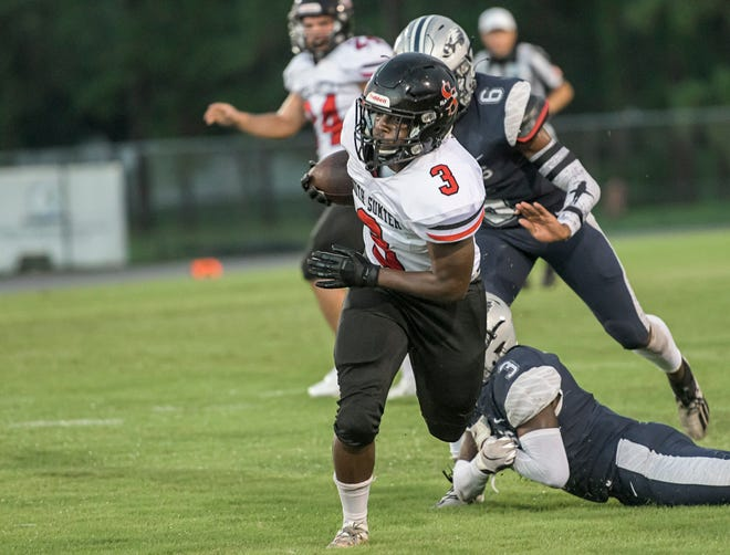 South Sumter's Jamare Dorsey (3) runs with the ball for yardage during Thursday's game against South Lake in Groveland. [PAUL RYAN / CORRESPONDENT]