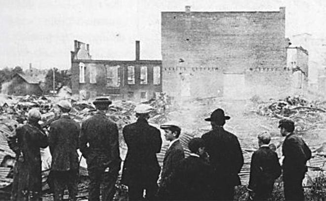 Employees and bystanders look over the smoldering remains of the Lion Motor Car Co. facility. The factory, located on Logan Street in Adrian, burned to the ground in just three hours on June 2, 1912. Tragically, the fire claimed the life of Christian Schoen, a 30-year veteran firefighter and the first Adrian firefighter to die in a fire.