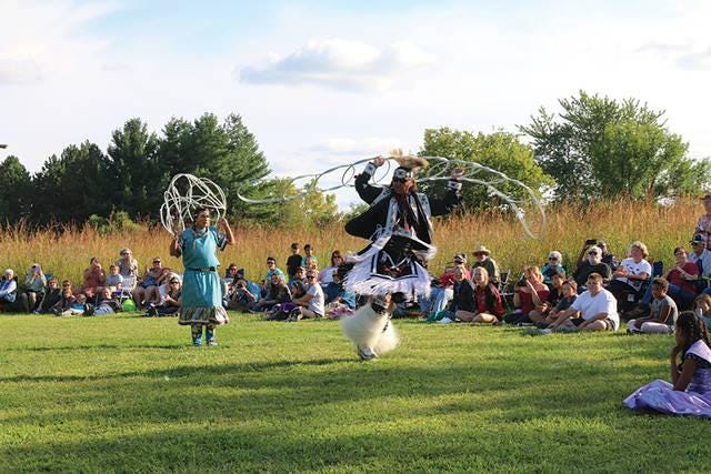 Dallas Chief Eagle, middle, performs a hoop dance at Prairie Awakening - Prairie Awoke in 2018. The 2021 event will return on Sept. 11 at Kuehn Conservation Area.