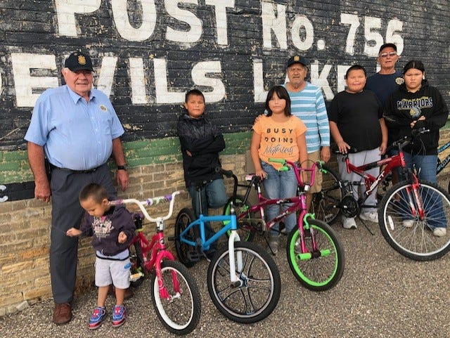 Two posts banded together to refurbish bicycles for children of the community.
