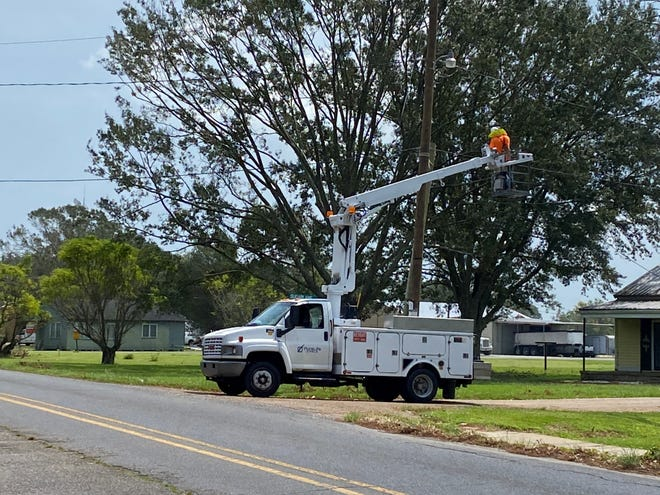 A lineman works on a power line Sept. 5 on Sugarlane Drive in Donaldsonville.