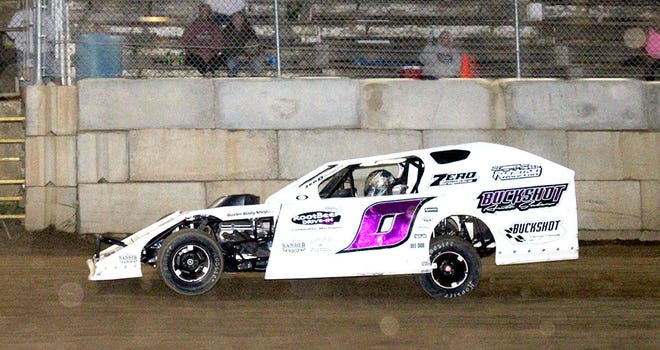 Tim Wilber (0) takes the checkered flag in the UMP Modified Division at Butler Motor Speedway