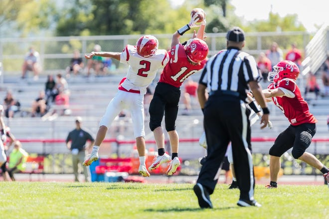 Ashton Davis leaps high into the air to bring the ball down as CG played host to Red Jacket on Saturday afternoon.