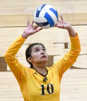 Garden City Community College's Remi Vargas sets the ball to a teammate during a home volleyball match in March at Perryman Athletic Complex.