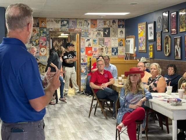 Gary Rabine, candidate for Governor, addresses several Cambridge residents during a town hall meeting September 2.