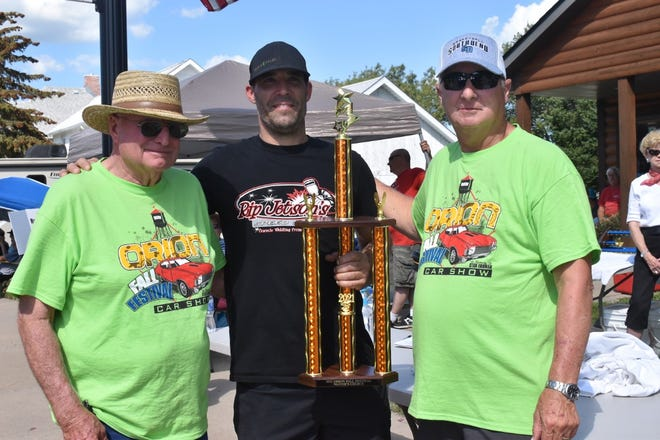Kyle Erdmann, center, received the Mayor's Choice award for a 1970 Chevy Nova at Orion Fall Festival's car show on Sunday, Sept. 5. Flanking him are car show chairman Jim DeBaillie, left, and Orion Village President Jim Cooper, right.