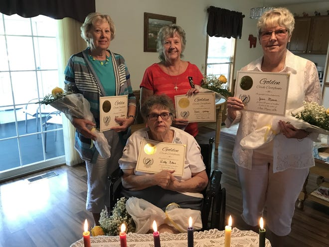 Pictured are front, Sally Nelson and back from left, Joyce Baskovic, Karan Ahlberg and Jean Mann who received  their Golden Circle  ritual for 50 years of membership  from the Galva Xi Kappa Gamma chapter. The ritual was held at the home of Nelson in Galesburg with President Vicki Perkins giving the ritual. Each received a rose, pin and certificate.