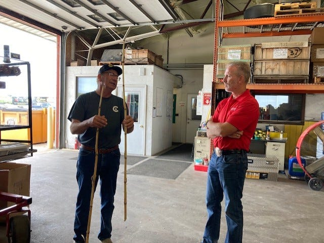 Businessman and candidate for governor, Gary Rabine talks with local manufacturer, Marion Calmer, about rural Illinois needs.