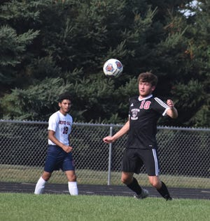 Orion-Sherrard's Cole Kimball chests the ball to control it in the first half of the varsity match on a hot and humid Tuesday, Aug. 24, at Charger Field. It was the season opener for United, which won 3-0 over DePue-Hall. The game ended just as a thunderstorm rolled in.
