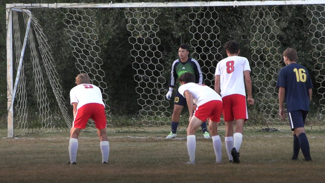 Hillsdale Hornet goalie Shane Martinez looks to stop a late minute penalty kick against Michigan Center.