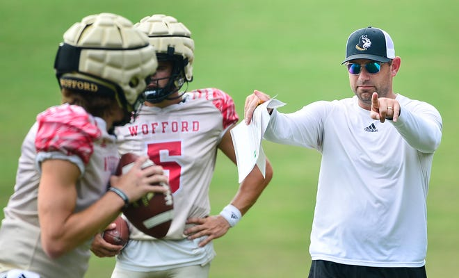 Wofford assistant football coach Tyler Carlton goes through passing drills on Sept 7. The Terriers are preparing for their home opener at 6 p.m. Saturday against Kennesaw State.