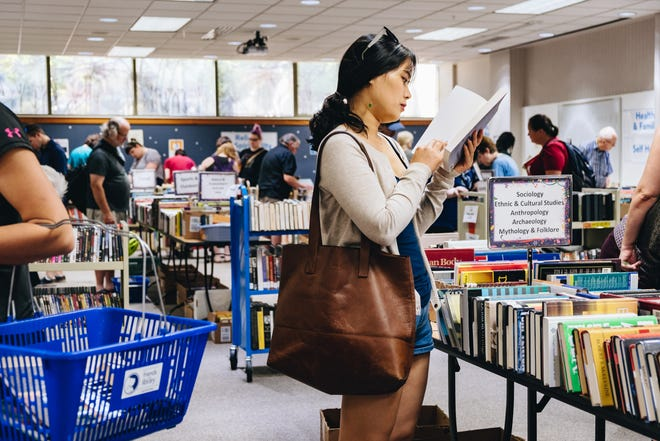 Customers browse during a previous Big Fall Book Sale. This year's sale at the Monroe County Public Library is open to the public 10 a.m.-6 p.m. Friday and Saturday, noon-6 p.m. Sunday and 10 a.m.-2 p.m. Monday in meeting room 1b/c at the main library.