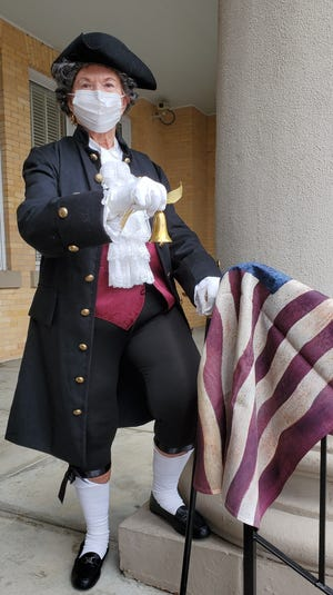 Costumed DAR members will ring bells at 4 p.m. Sept. 17 as they join thousands of others across America in celebrating Constitution Week. In this photo, Fran Hart (Nicolas Gilmer descendant) participates in Bells Across America in 2020.