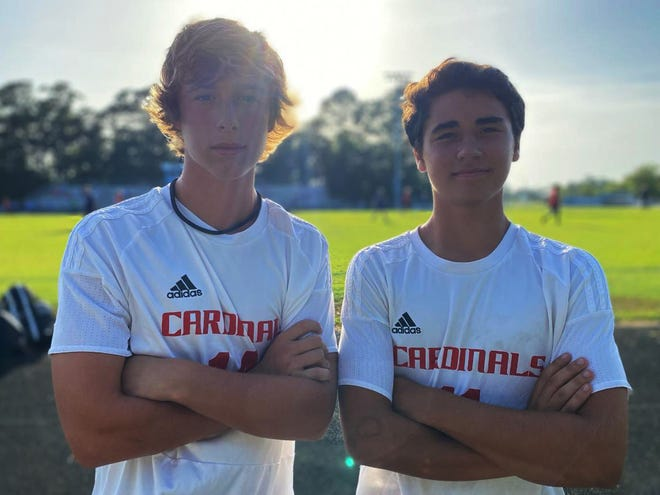 Jacksonville sophomore soccer players Slayton Owens, left, and Nate Mahouchick grew up around the Cardinals' program. Owens watched as his two sisters played for the Cardinals while Mahouchick watched as his father, Joey, helped coach.